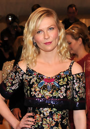 Kirsten Dunst wore 19th Century  blue enamel, pearl and diamond pendant earrings in silver on gold to the 2011 Met Gala.