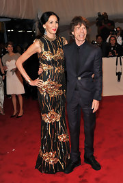 Mick Jagger went to the 2011 Costume Institute Gala in a classy midnight blue pinstripe suit.
