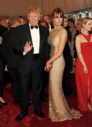 87f453daa5d Melania was a beauty at the Met Gala in a sparkling gold evening gown.