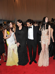 Marina Abramovic oozed sophistication in a long-sleeve feather-embellished black evening dress.