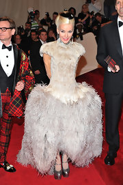 Daphne Guinness paid tribute to friend Alexander McQueen in a lilac feathered ball gown with a full sculpted waist.