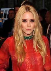 Mary-Kate Olsen added a soft feminine touch to her look with petal pink lipstick at the 2011 Met Gala.