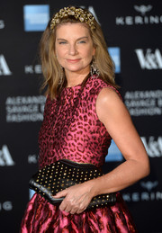 Natalie Massenet accessorized with an edgy black studded clutch when she attended the Alexander McQueen: Savage Beauty private view.