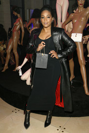 Tiffany Haddish amped up the edge factor with a black leather coat.