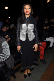 Taraji P. Henson arrived for the Alexander Wang fashion show wearing a leather-and-plaid jacket from the brand.