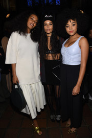 Amandla Stenberg showed her sexier side in a ruched baby-blue tank top while attending the Alexander Wang fashion show.