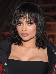 Kylie Jenner finished off her beauty look with a glossy nude lip.