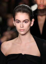 Kaia Gerber walked the Alexander Wang runway wearing her hair in a slick updo.