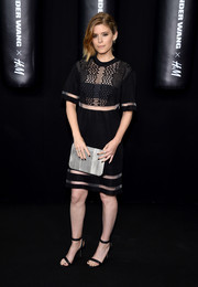 Kate Mara accessorized with plain black strappy sandals at the Alexander Wang x H&M launch.