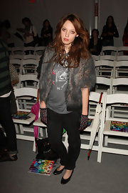 Cory completed her graphic T-shirt and black flats with a fur coat.