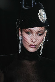 Bella Hadid looked posh wearing this veiled and bejeweled hat at the Alexandre Vauthier Couture Fall 2017 show.