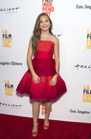 Maddie Ziegler finished off her look with red-orange peep-toe heels by Jimmy Choo.