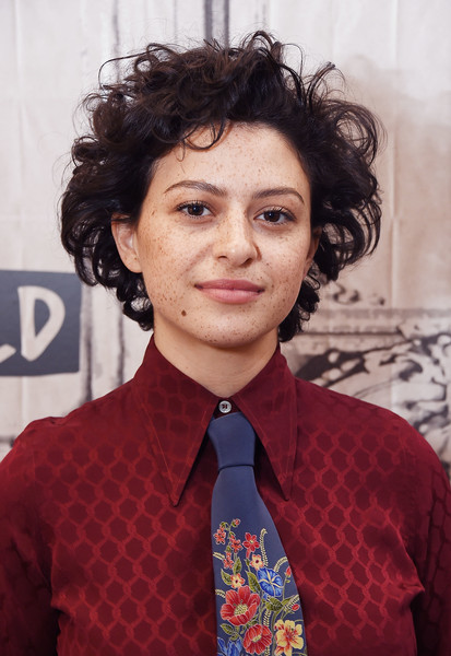 Alia Shawkat Short Curls [show,hair,hairstyle,eyebrow,forehead,chin,black hair,white-collar worker,smile,alia shawkat,alia shawkat john reynolds,build presents,new york city,search party,build studio]