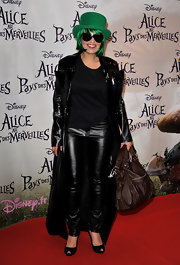 "At the premiere of ""Alice and Wonderland"" singer Laam showed off her love of leather and apparently St. Patrick's day. She topped her odd look off with a brown leather tote bag, which was the only normal thing about her outfit."