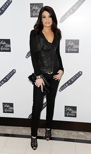 From her motorcycle vest all the way down to her black mesh peep-toe booties, Kimberly Guilfoyle oozed an edgy-chic vibe at the Alice + Olivia launch party.