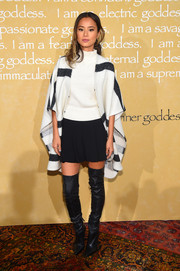 Jamie Chung pulled her outfit together with a striped poncho, also by Alice + Olivia.