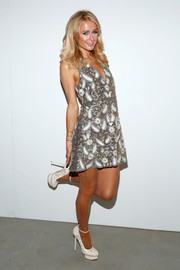 Paris Hilton was a cutie in her Alice + Olivia paisley-embroidered mini dress during the brand's presentation.