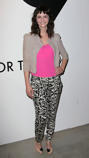 Alexandra Ella arrived at the All In for the 99% Event wearing a pair of nude pumps with black accents.