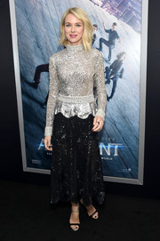 Naomi Watts completed her black and silver-themed ensemble with a pair of ankle-strap heels.
