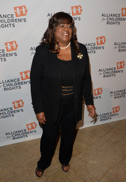 Chaz Ebert looked smart in a black pantsuit styled with a gold chain belt during the Alliance for Children's Rights dinner.