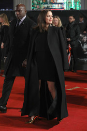 Marion Cotillard kept warm with a long black coat as she arrived for the UK premiere of 'Allied.'