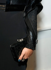 Crystal Renn accessorized with a spotted black box clutch at the Alon Livne Spring 2014 show.