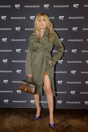 Eleonora Carisi was tough-chic in an army-green trenchcoat at the AlphaTauri PR launch event.
