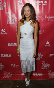 Jamie Chung chose a white cutout pencil skirt to team with her top.