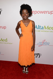 Amanda Gorman looked chic in an orange cocktail dress at the AltaMed Power Up, We Are The Future Gala.