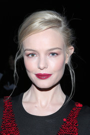 Kate Bosworth swiped on some raspberry lipstick to finish off her look.