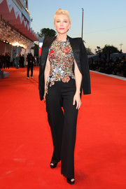 Cate Blanchett went the menswear-chic route in a black tuxedo and floral top combo by Alexander McQueen at the Venice Film Festival screening of 'Amants.'