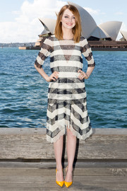 Emma Stone kept it breezy in a sheer black-and-white striped blouse by Chloe during the 'Amazing Spider-Man 2' photocall in Sydney.