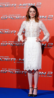 Emma Stone was classic and feminine in a white lace button-down by Dolce & Gabbana during the 'Amazing Spider-Man 2' photocall in Rome.