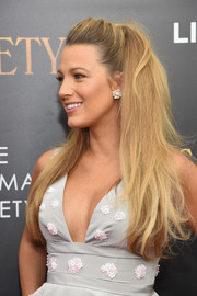 Blake Lively framed her lovely face with a pair of floral diamond studs.