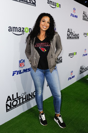 Jordin Sparks wore a gray leather jacket over an Arizona Cardinals shirt for the premiere of 'All or Nothing.'