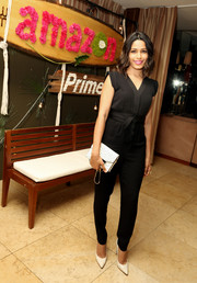 Freida Pinto styled her outfit with a cute black-and-white dotted clutch, also by Kate Spade New York.