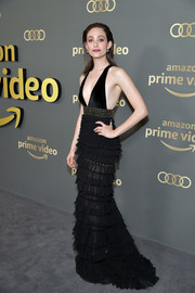 Emmy Rossum was sexy and sophisticated in a black J. Mendel gown with a plunging neckline, a studded waistband and a tiered and ruffled skirt at the Amazon Prime Video Golden Globes after-party.