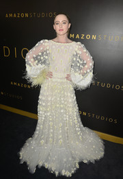 Kathryn Newton looked angelic at the Amazon Studios Golden Globes after-party in a pale yellow Valentino gown that was dotted with floral embroidery.