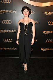 Alia Shawkat chose an ankle-length black dress with an illusion yoke for the Amazon Studios Golden Globes celebration.