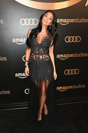 Nicole Scherzinger flashed plenty of skin in a sheer, lace-detail gown by Rhea Costa at the Amazon Studios Golden Globes celebration.