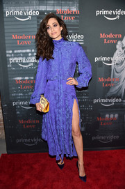 Emmy Rossum punctuated her purple outfit with a yellow frame clutch by Roger Vivier.