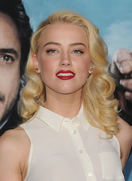 Amber Heard Red Lipstick [sherlock holmes: a game of shadows,hair,eyebrow,blond,beauty,human hair color,hairstyle,lip,chin,fashion model,long hair,arrivals,amber heard,los angeles,regency village theatre,california,warner bros. pictures,westwood,premiere]