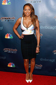 Melanie Brown added more sexiness to her look with a hip-hugging black skirt.