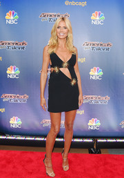 Heidi Klum looked as ravishing as ever in a tiny black cutout dress by Fausto Puglisi, embellished with the label's signature's sunburst motif, at the 'America's Got Talent' season 10 taping.