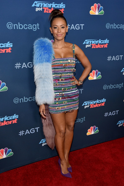 Melanie Brown packed her curves into a multi-buckled, rainbow-striped mini dress for the 'America's Got Talent' season 11 live show.