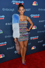Melanie Brown accessorized with a tricolor fur stole for more pizzazz.