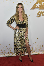 Heidi Klum glittered in a gold and black sequin dress at the 'America's Got Talent' season 13 live show.