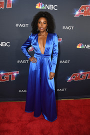 Gabrielle Union rocked a down-to-the-navel neckline with this electric-blue satin jumpsuit from her New York & Company collection at the 'America's Got Talent' season 14 live show.