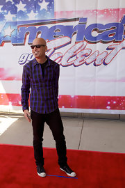 Howie Mandel chose a bright purple plaid button down to bring some color and fun to his red carpet look at the 'America's Got Talent' event in Illinois.