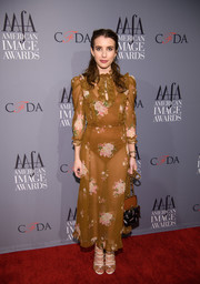 Emma Roberts complemented her dress with a pair of tan and white lace-up heels by Malone Souliers.